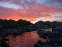 Cabo Fire. Fiery sky at the harbor in Cabo San Lucas, Mexico stock images