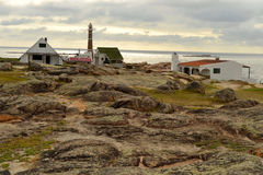 Cabo Polonio房子和灯塔 免版税图库摄影
