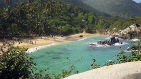 CABO SAN JUAN DE LA GUÍA, TAYRONA NATIONAL PARK, COLOMBIA - People enjoy their vacations at the beach