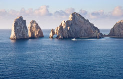 Cabo San Lucas. Fishing boat sailing by Los Arcos in Cabo San Lucas, Mexico royalty free stock photos