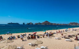Cabo San Lucas beach front. Cabo San Lucas, Mexico- April 27/2016: Vendors sell there wares and services to tourists in front of a resort in Cabo San Lucas as a Royalty Free Stock Images