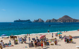 Cabo San Lucas beach front. Cabo San Lucas, Mexico- April 27/2016: Vendors sell there wares and services to tourists in front of a resort in Cabo San Lucas as a Stock Photography
