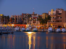 Cabo San Lucas, Marina at night. View of the Cabo San Lucas Marina at dusk with fishing boats in the harbor and the boardwalk. Modern construction and palm trees royalty free stock photos