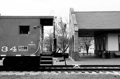 Caboose at the depot in black and white Stock Photos