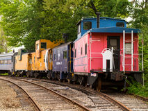 Caboose Village, Tilton, NH. Colorful, privately owned, decommissioned cabooses stored at the Northfield, New Hampshire freight yard in Tilton, NH.  The club of Royalty Free Stock Photos