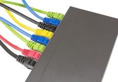 Cabos da rede conectados ao roteador Imagens de Stock