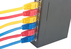 Cabos da rede conectados ao roteador Foto de Stock