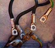 Cabos distribuidores de corrente velhos com terminal do ilhó Imagem de Stock Royalty Free