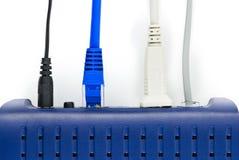 Cabos e modem Fotografia de Stock