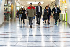 Cabot Place in Canary Wharf with office workers walking stock image