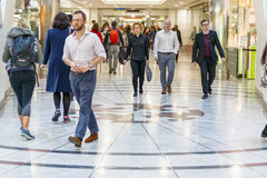Cabot Place in Canary Wharf with office workers walking after work royalty free stock photography
