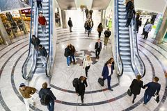 Cabot Place in Canary Wharf with people up and down on escalator stock photo