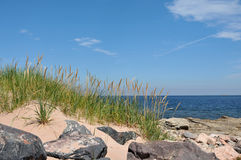 Cabot Trail. Beach grass, rocks, and sand at a beach along the Cabot Trail stock photo