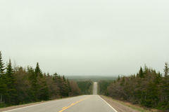 Cabot Trail Highway no dia nebuloso Fotografia de Stock Royalty Free