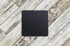Caboteur carré sur le fond en bois Image libre de droits