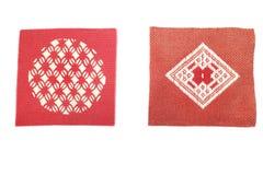 Caboteur tricoté rouge et brun japonais dans le blanc images libres de droits