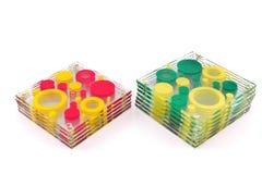 Caboteurs colorés pour le verre d'isolement sur le blanc Photos libres de droits