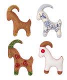 Cabra Toy Set Ejecución de la decoración de la Navidad, fondo blanco Imágenes de archivo libres de regalías