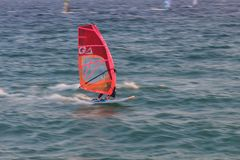 Cabrera de Mar,Barcelona/Spain; 02 08 2019: A good afternoon to practice Windsurfing and Kitesurfing Flysurf at Cabrera beach at. Sunset with the waves of the royalty free stock photo