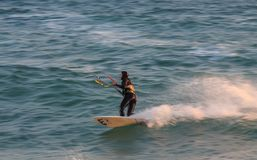 Cabrera de Mar,Barcelona/Spain; 02 08 2019: A good afternoon to practice Windsurfing and Kitesurfing Flysurf at Cabrera beach at. Sunset with the waves of the royalty free stock images