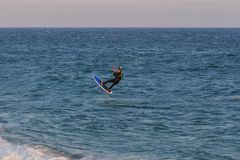 Cabrera de Mar,Barcelona/Spain; 02 08 2019: A good afternoon to practice Windsurfing and Kitesurfing Flysurf at Cabrera beach at. Sunset with the waves of the stock image