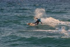 Cabrera de Mar,Barcelona/Spain; 02 08 2019: A good afternoon to practice Windsurfing and Kitesurfing Flysurf at Cabrera beach at. Sunset with the waves of the royalty free stock photos