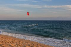 Cabrera de Mar,Barcelona/Spain; 02 08 2019: A good afternoon to practice Windsurfing and Kitesurfing Flysurf at Cabrera beach at royalty free stock photos