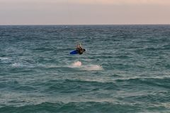 Cabrera de Mar,Barcelona/Spain; 02 08 2019: A good afternoon to practice Windsurfing and Kitesurfing Flysurf at Cabrera beach at. Sunset with the waves of the royalty free stock photography
