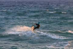 Cabrera de Mar,Barcelona/Spain; 02 08 2019: A good afternoon to practice Windsurfing and Kitesurfing Flysurf at Cabrera beach at. Sunset with the waves of the stock images