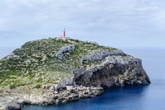 Cabrera island lighthouse. Cabrera island. Old lighthouse on the rock cape royalty free stock image