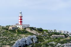 Cabrera island lighthouse. Cabrera island. Old lighthouse on the rock cape. Spain stock photos