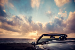 Cabriolet against blue sky background Royalty Free Stock Photo