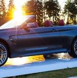 Cabriolet auto en de zon stock afbeeldingen