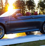 Cabriolet car and the sun Stock Images