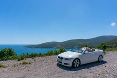 Cabriolet convertible roadster parked on the street stock images