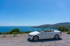 Cabriolet convertible roadster parked on the street royalty free stock photos