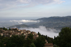 Cabris, France. View of Mediterranean sea and town of Cabris, France as fog approaches royalty free stock photo