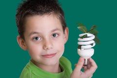Cabrito con el bulbo ahorro de energía Imágenes de archivo libres de regalías
