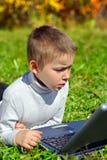 Cabrito con el cuaderno Foto de archivo libre de regalías