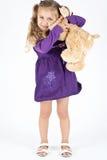 Cabrito con el oso de peluche Fotos de archivo