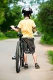 Cabrito con la bicicleta Fotos de archivo libres de regalías