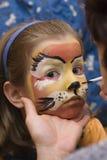 Cabrito con la cara coloreada partido Fotografía de archivo