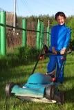 Cabrito divertido del lawnmore Imagen de archivo