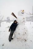 Cabrito y muñeco de nieve Imagenes de archivo