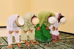 Cabritos del Islam que ruegan foto de archivo