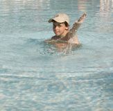 Cabritos en la piscina Foto de archivo libre de regalías