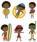 Cabritos felices del African-American en la playa Foto de archivo libre de regalías