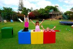 Cabritos felices en patio Foto de archivo libre de regalías