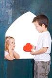 Cabritos felices que juegan amor Foto de archivo