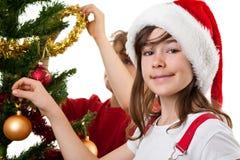 Cabritos que adornan el árbol de navidad Imágenes de archivo libres de regalías
